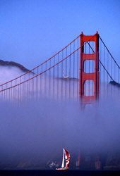 Photo: Golden Gate Bridge with sail boat emerging from fog, San Francisco, CA