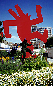 Nicki Michaels with niece Kaitlin and nephew Sean in front of a sculpture by artist Keith Haring near the San Francisco Museum of Modern Art where a major retrospective of Harings work was showing in 1998